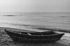 Little fishing boat lying on the beach Royalty Free Stock Photos