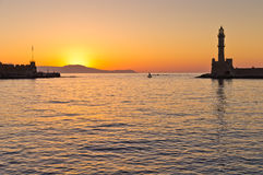 Little fishing sailboat at the entrance of harbour. Little fishing sail boat passing the entrance to Hanja harbour at sunset. Hanja is one of the oldest cities stock photography