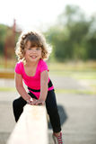 Little fit girl plays on playground Royalty Free Stock Photography