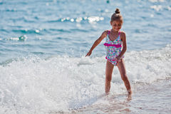 Little five year old girl at the beach Royalty Free Stock Photos