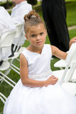 Little Flower Girl. With a Somber Look Royalty Free Stock Image