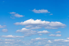 Little fluffy white clouds in blue sky Stock Image