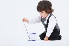 Little focused boy touches portable radio with ant Royalty Free Stock Photos