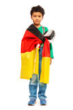 Little football fan wrapped in flag of Germany Stock Photography