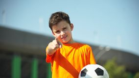 The little football goalkeeper catches a ball and throws back stock video footage