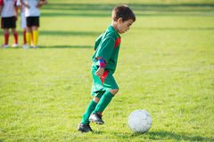 Little football player Stock Photo