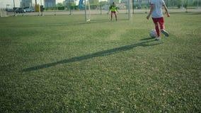 Little footballer is running and kicking goal. In sport stadium stock video footage