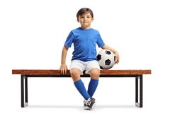 Little footballer sitting on a bench Royalty Free Stock Images