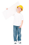 Little foreman presenting blank. Portrait of little foreman or construction worker presenting blank board,  on white background Royalty Free Stock Photo