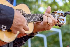Little four strings acoustic guitar. Live musical performance of Brazilian popular music called chorinho with little acoustic guitar with four strings royalty free stock photography