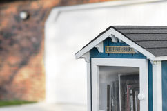 Little free library erected on suburban street by resident Royalty Free Stock Photo