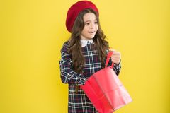 Little french lady adore shopping. Birthday girl. Favorite brands hottest trends. Girl with shopping bag. Explore. Fashion industry. Shopping and purchase royalty free stock image