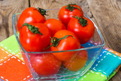 Little fresh tomatoes in a bowl. Studio Photo Stock Photo