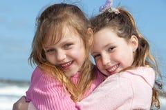 Little friends. Portrait of two cute little girls outdoors stock photo