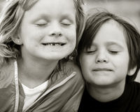 Little Friends. Caring and playful little cousin friends Stock Photo