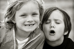 Little Friends. Caring and playful little cousin friends Stock Image