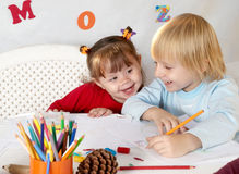Little friends at a drawing lesson. Two little friends at a drawing lesson Stock Images