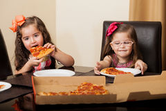 Little friends eating pizza Stock Photo
