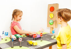 Little friends having fun playing drivers stock photo
