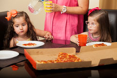 Little friends having pizza at home Stock Images