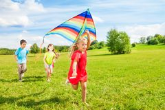 Little friends with kite Stock Image