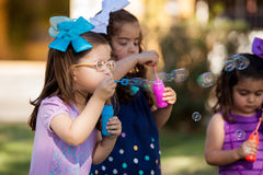 Little friends making bubbles Royalty Free Stock Photo