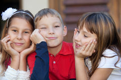 Little friends. Portrait of tree kids outdoors daydreaming stock photography
