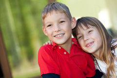 Little friends. Portrait of two smiling kids outdoor stock photos