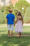 Little friends walk holding hands Royalty Free Stock Photos