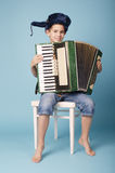 Little funny accordion player stock photography