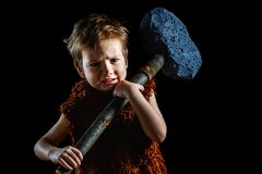 Little funny angry warrior boy. Neanderthal or a Cro-Magnon. Ancient caveman,   ancient. Little funny angry warrior boy is a Neanderthal or a Cro-Magnon. Ancient royalty free stock photography