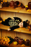 Little funny baby with bee costume Stock Image