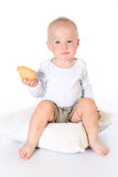 Little funny baby boy holds and eats cookies Stock Images