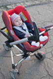 Little funny baby in carriage Stock Image