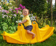 Little funny baby on his favorite swing. Boy is smiling Stock Photography