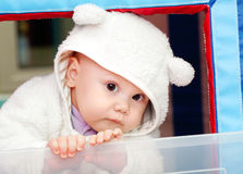 Little funny baby in white bear costume Royalty Free Stock Image
