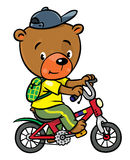 Little funny bear on bicycle Royalty Free Stock Images