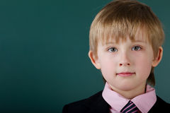 Little funny boy with blackboard Stock Images