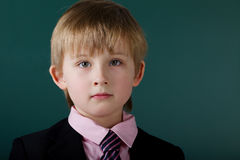 Little funny boy with blackboard Royalty Free Stock Photos