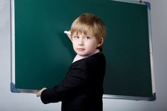 Little funny boy with blackboard Royalty Free Stock Images