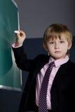 Little funny boy with blackboard Stock Photo