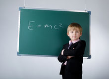 Little funny boy with blackboard Royalty Free Stock Photo