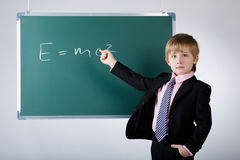 Little funny boy with blackboard Royalty Free Stock Image