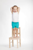 Little funny boy on chair Royalty Free Stock Photo