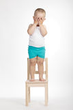Little funny boy on chair Stock Photo