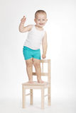 Little funny boy on chair Royalty Free Stock Image