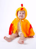 Little funny boy in chicken costume. On white Royalty Free Stock Photos