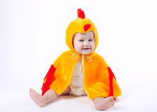 Little funny boy in chicken costume. On white Royalty Free Stock Image