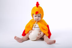 Little funny boy in chicken costume. On white Stock Photo