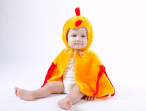 Little funny boy in chicken costume. On white Stock Photos